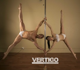 Andrea James Lui pole trick Iron X with Chris Talbot aka Blue Phoenix Pole and Fitness at Arena Pole Studio by Brad Edwards Vertigo Photography