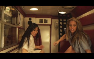 Bail Enforcers screen shot of Andrea James Lui as Ruby & Trish Stratus as Jules in the ambulance