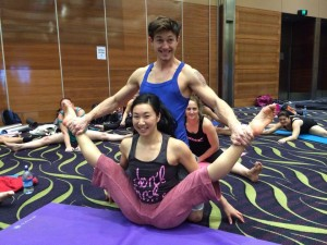Andrea James Lui Middle Splits stretch with Alex Shchukin in Flexibility at West Australian Pole Camp 2014
