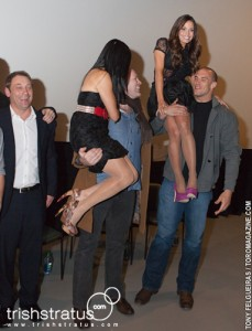 Andrea James Lui & Trish Stratus being carried by Toronto Argos at the Bounty Hunters Premiere