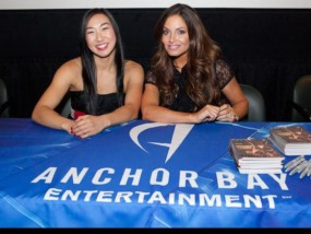 Andrea James Lui & Trish Stratus signing autographs at the Bounty Hunters premiere