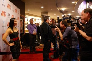 Andrea James Lui posing on the red carpet for Bounty Hunters